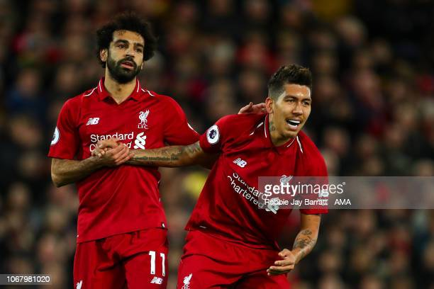 Mohamed Salah of Liverpool and Roberto Firmino of Liverpool during the Premier League match between Liverpool FC and Everton FC at Anfield on...