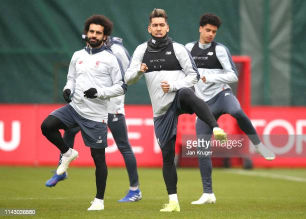 Mohamed Salah of Liverpool and Roberto Firmino of Liverpool train during the Liverpool training session on the eve of the UEFA Champions League...