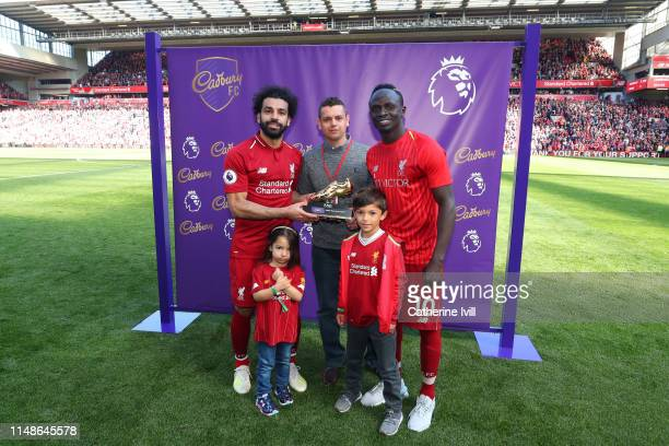 Mohamed Salah of Liverpool and Sadio Mane of Liverpool pose with the golden boot trophy after the Premier League match between Liverpool FC and...