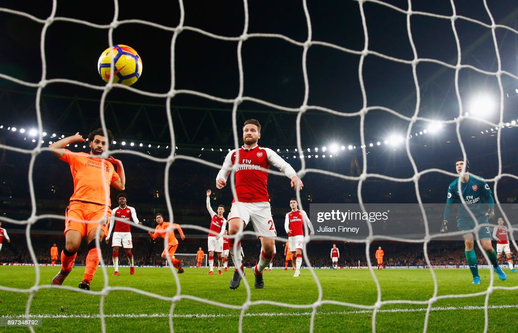 Mohamed Salah of Liverpool and Shkodran Mustafi and Petr Cech of Arsenal watch the ball bounce into the net as Roberto Firmino of Liverpool (C) scores their third goal during the Premier League match between Arsenal and Liverpool at Emirates Stadium on December 22, 2017 in London, England.