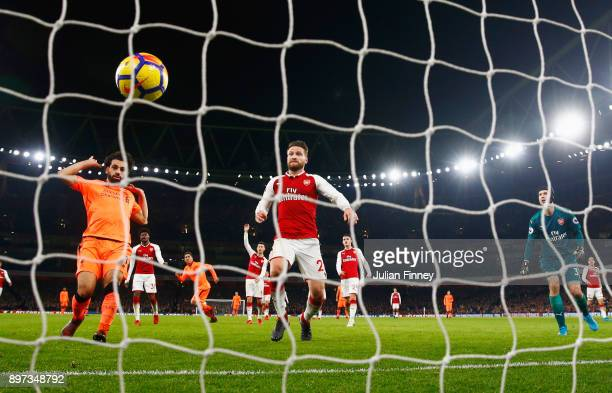 Mohamed Salah of Liverpool and Shkodran Mustafi and Petr Cech of Arsenal watch the ball bounce into the net as Roberto Firmino of Liverpool scores...