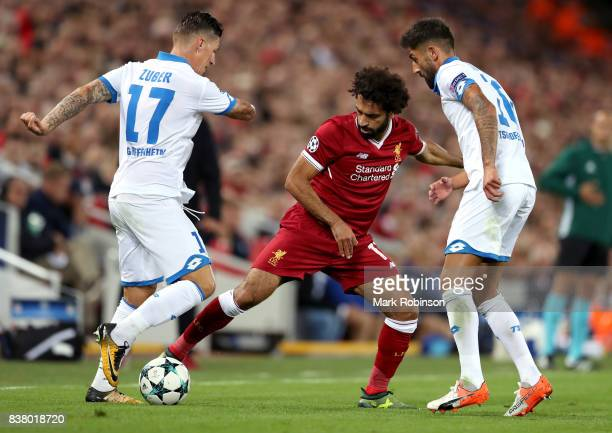 Mohamed Salah of Liverpool and Steven Zuber of Hoffenheim battle for possession during the UEFA Champions League Qualifying PlayOffs round second leg...
