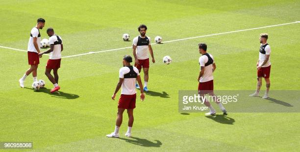 Mohamed Salah of Liverpool and team mates in action during a training session at Anfield on May 21 2018 in Liverpool England