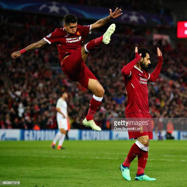 Mohamed Salah of Liverpool and teammate Roberto Firmino celebrate after scoring his sides second goal during the UEFA Champions League Semi Final...