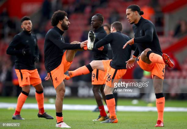 Mohamed Salah of Liverpool and teammate Virgil van Dijk warm up prior to the Premier League match between Southampton and Liverpool at St Mary's...
