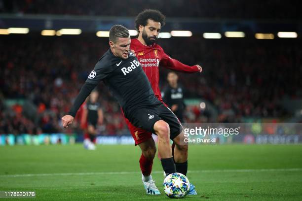 Mohamed Salah of Liverpool and Zlatko Junuzovic of Red Bull Salzburg during the UEFA Champions League group E match between Liverpool FC and RB...
