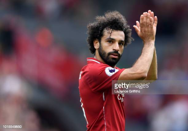Mohamed Salah of Liverpool applauds fans during the Premier League match between Liverpool FC and West Ham United at Anfield on August 12 2018 in...