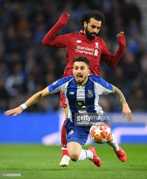Mohamed Salah of Liverpool battles for possession with Alex Telles of FC Porto during the UEFA Champions League Quarter Final second leg match...