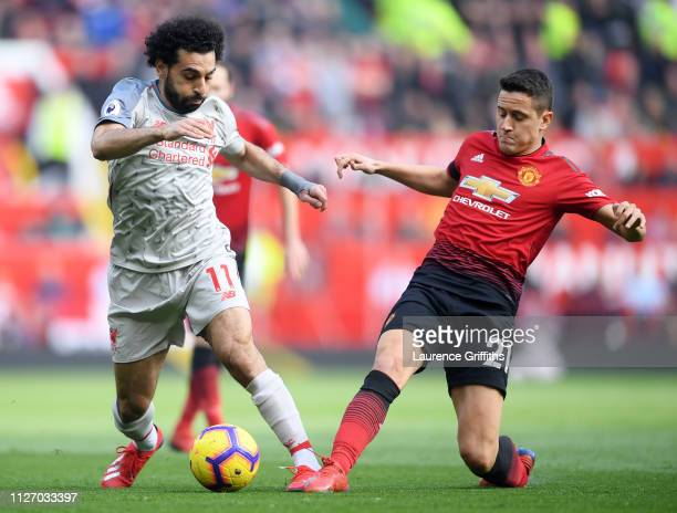 Mohamed Salah of Liverpool battles for possession with Ander Herrera of Manchester United during the Premier League match between Manchester United...