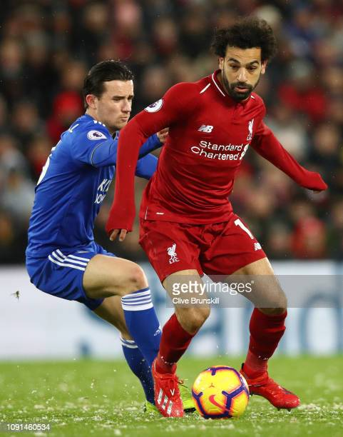 Mohamed Salah of Liverpool battles for possession with Ben Chilwell of Leicester City during the Premier League match between Liverpool FC and...