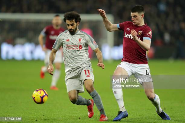Mohamed Salah of Liverpool battles for possession with Declan Rice of West Ham United during the Premier League match between West Ham United and...