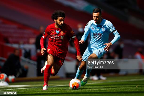 Mohamed Salah of Liverpool battles for possession with Dwight McNeil of Burnley during the Premier League match between Liverpool FC and Burnley FC...