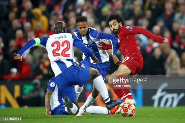 Mohamed Salah of Liverpool battles for possession with Eder Militao and Danilo Pereira of FC Porto during the UEFA Champions League Quarter Final...