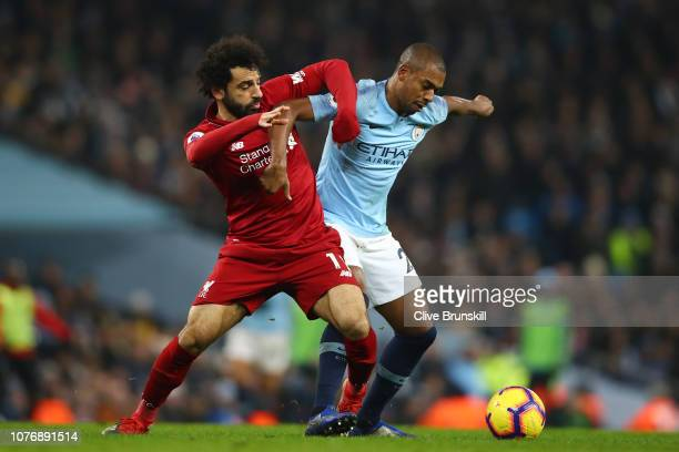 Mohamed Salah of Liverpool battles for possession with Fernandinho of Manchester City during the Premier League match between Manchester City and...