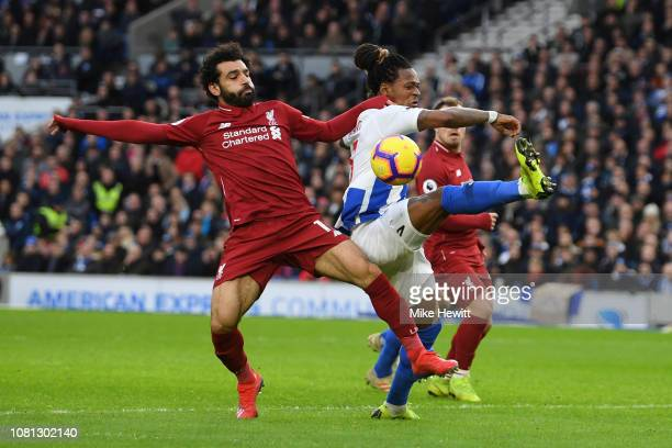 Mohamed Salah of Liverpool battles for possession with Gaetan Bong of Brighton and Hove Albion during the Premier League match between Brighton Hove...