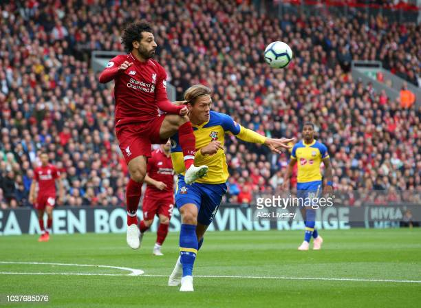 Mohamed Salah of Liverpool battles for possession with Jannik Vestergaard of Southampton during the Premier League match between Liverpool FC and...