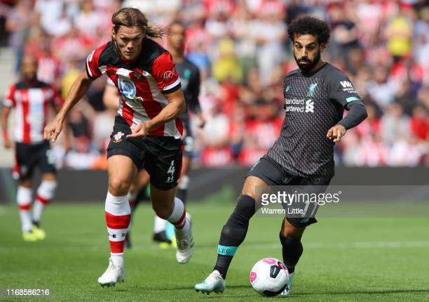 Mohamed Salah of Liverpool battles for possession with Jannik Vestergaard of Southampton during the Premier League match between Southampton FC and...