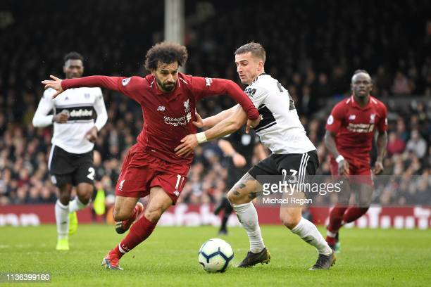 Mohamed Salah of Liverpool battles for possession with Joe Bryan of Fulham during the Premier League match between Fulham FC and Liverpool FC at...