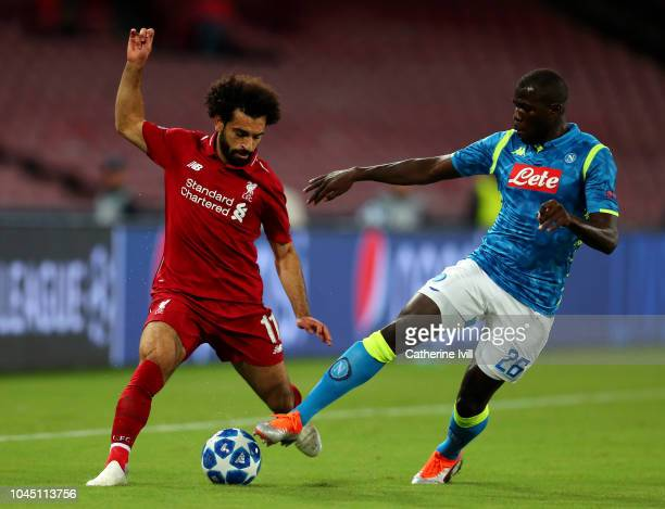 Mohamed Salah of Liverpool battles for possession with Kalidou Koulibaly of Napoli during the Group C match of the UEFA Champions League between SSC...
