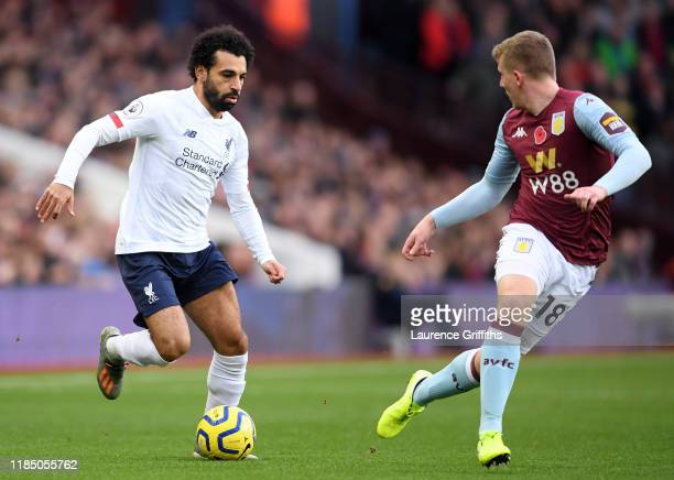 Mohamed Salah of Liverpool battles for possession with Matt Targett of Aston Villa during the Premier League match between Aston Villa and Liverpool...