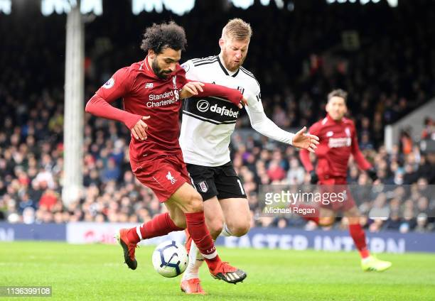 Mohamed Salah of Liverpool battles for possession with Tim Ream of Fulham during the Premier League match between Fulham FC and Liverpool FC at...