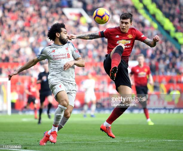Mohamed Salah of Liverpool battles for possession with Victor Lindelof of Manchester United during the Premier League match between Manchester United...