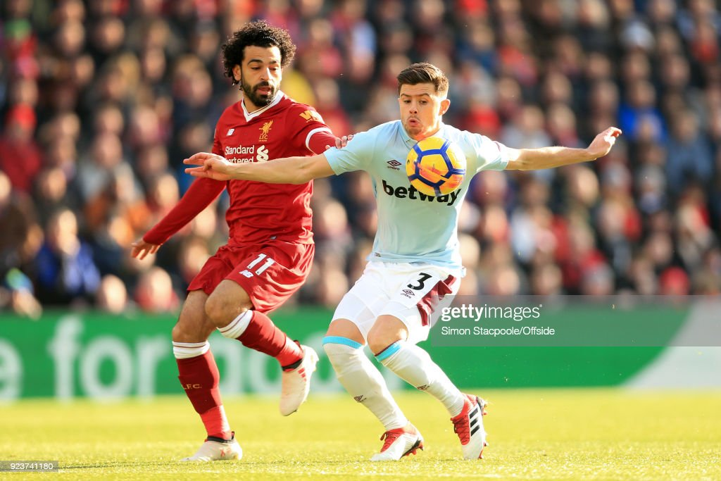 Mohamed Salah of Liverpool battles with Aaron Cresswell of West Ham during the Premier League match between Liverpool and West Ham United at Anfield on February 24, 2018 in Liverpool, England.