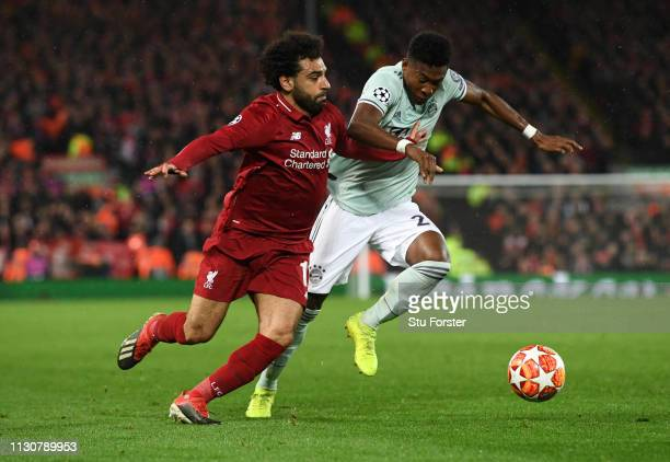Mohamed Salah of Liverpool battles with David Alaba of Bayern Munich during the UEFA Champions League Round of 16 First Leg match between Liverpool...