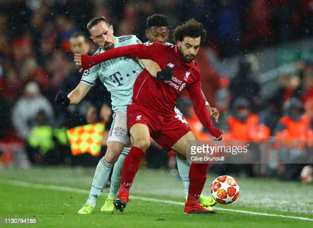 Mohamed Salah of Liverpool battles with Franck Ribery and David Alaba of Bayern Munich during the UEFA Champions League Round of 16 First Leg match...