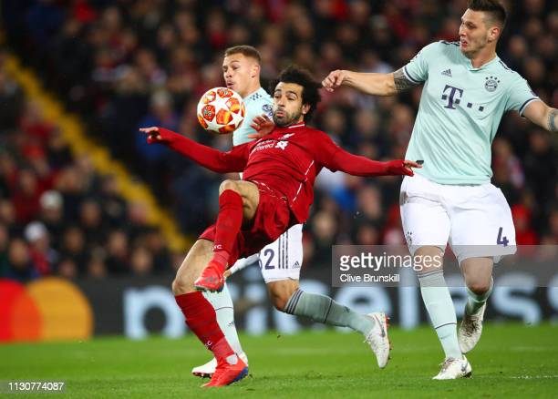 Mohamed Salah of Liverpool battles with Joshua Kimmich and Niklas Suele of Bayern Munich during the UEFA Champions League Round of 16 First Leg match...