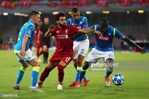 Mohamed Salah of Liverpool battles with Kalidou Koulibaly of Napoli during the Group C match of the UEFA Champions League between SSC Napoli and...