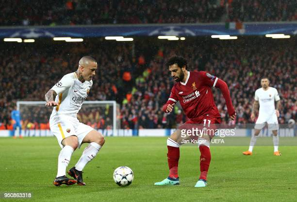 Mohamed Salah of Liverpool battles with Radja Nainggolan of AS Roma during the UEFA Champions League Semi Final First Leg match between Liverpool and...