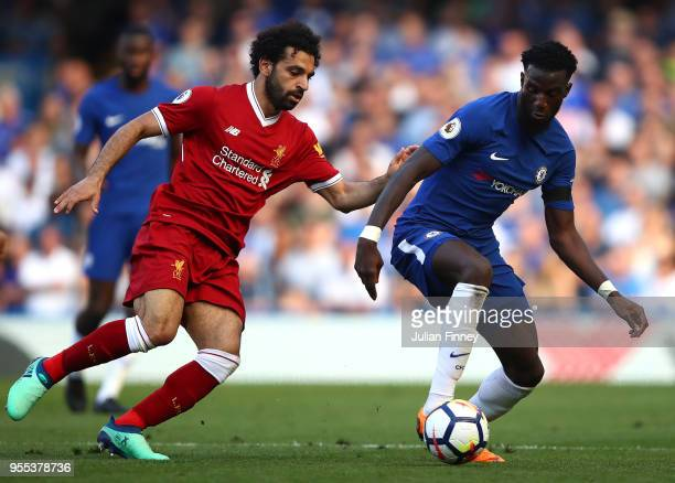 Mohamed Salah of Liverpool battles with Tiemoue Bakayoko of Chelsea during the Premier League match between Chelsea and Liverpool at Stamford Bridge...