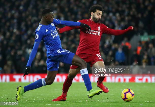 Mohamed Salah of Liverpool battles with Wilfred Ndidi of Leicester City during the Premier League match between Liverpool FC and Leicester City at...