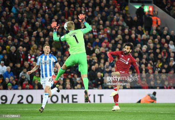 Mohamed Salah of Liverpool beats Jonas Lossl of Huddersfield Town as he scores his team's third goal during the Premier League match between...