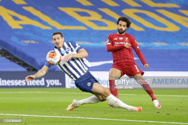 Mohamed Salah of Liverpool beats Lewis Dunk of Brighton & Hove Albion to the ball scores a goal to make it 1-0 during the Premier League match...