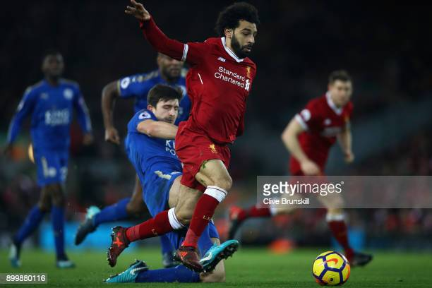 Mohamed Salah of Liverpool breaks past Harry Maguire of Leicester City to score his team's second goal during the Premier League match between...
