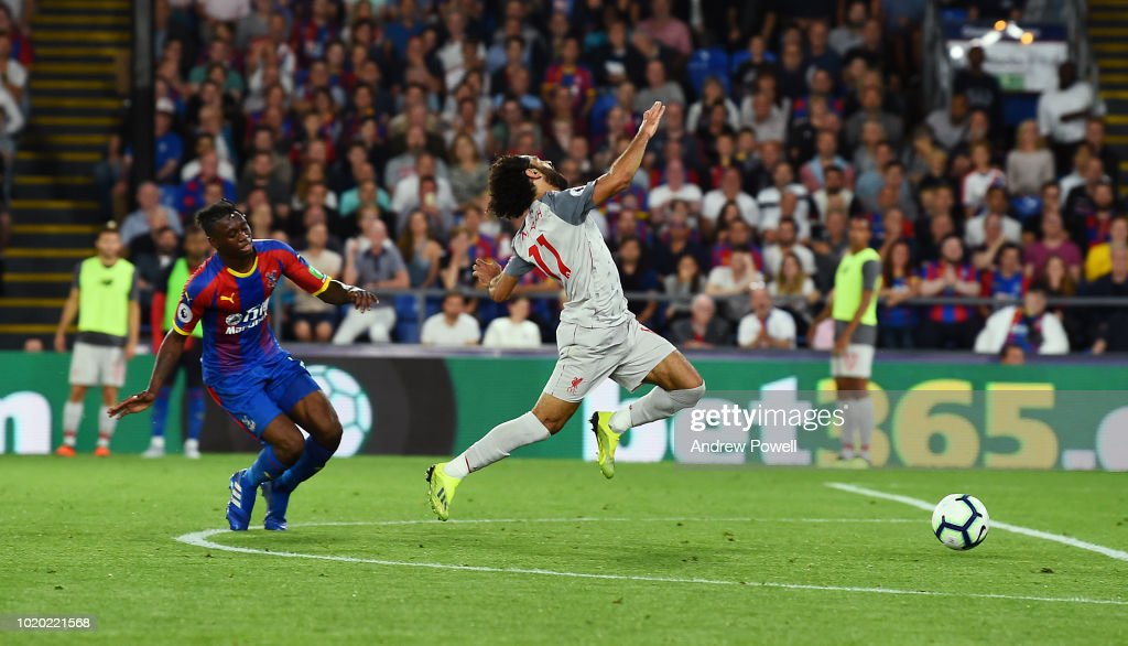 Mohamed Salah of Liverpool brought down by Aaron Wan-Bissaka of Crystal Palace during the Premier League match between Crystal Palace and Liverpool FC at Selhurst Park on August 20, 2018 in London, United Kingdom.
