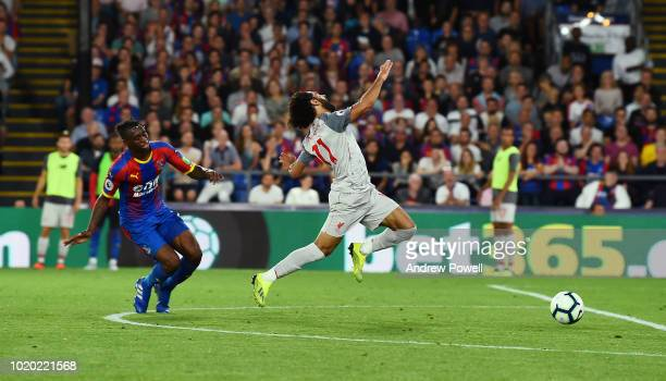 Mohamed Salah of Liverpool brought down by Aaron WanBissaka of Crystal Palace during the Premier League match between Crystal Palace and Liverpool FC...