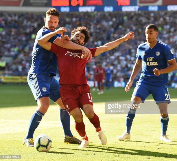 Mohamed Salah of Liverpool brought down in the box of a penalty by Sean Morrison of Cardiff City during the Premier League match between Cardiff City...