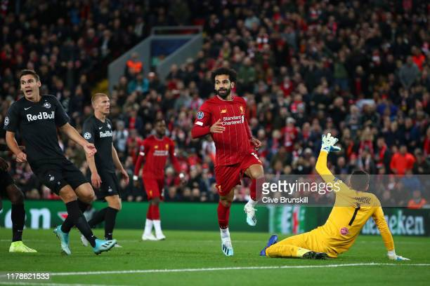 Mohamed Salah of Liverpool celebrates after he scores his sides fourth goal during the UEFA Champions League group E match between Liverpool FC and...