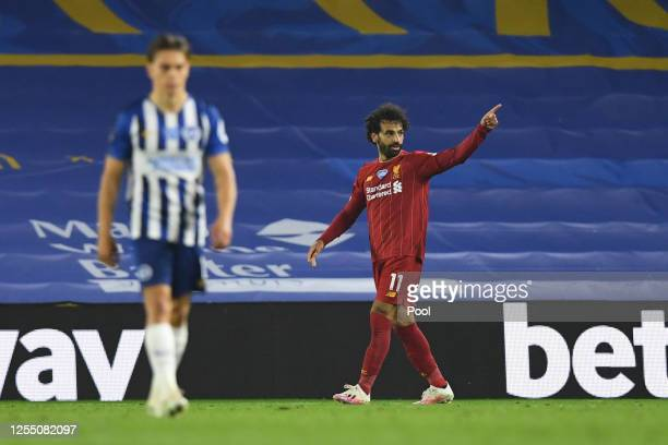 Mohamed Salah of Liverpool celebrates after he scores his sides third goal during the Premier League match between Brighton Hove Albion and Liverpool...