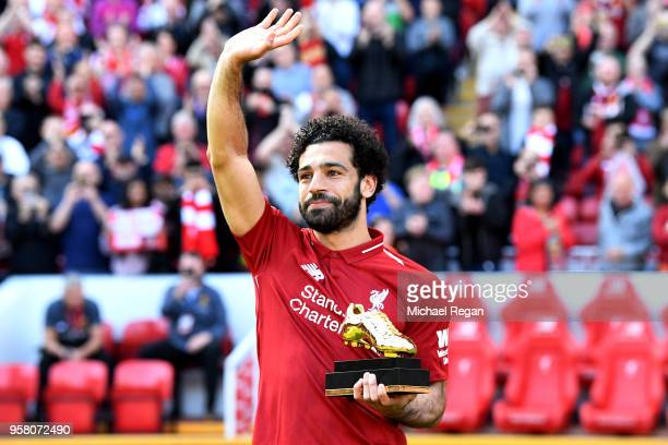 Mohamed Salah of Liverpool celebrates after receiving his Premier League Golden Boot Award after the Premier League match between Liverpool and...