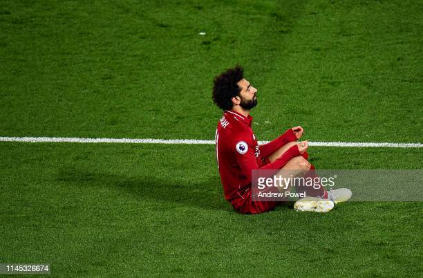 Mohamed Salah of Liverpool celebrates after scoring a goal during the Premier League match between Liverpool FC and Huddersfield Town at Anfield on...
