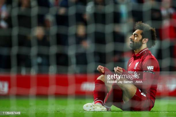 Mohamed Salah of Liverpool celebrates after scoring a goal to make it 5-0 during the Premier League match between Liverpool FC and Huddersfield Town...