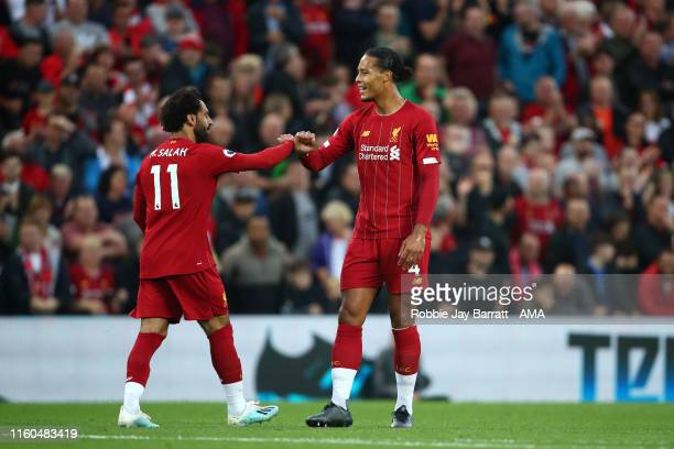 Mohamed Salah of Liverpool celebrates after scoring a goal to make it 20 with Virgil Van Dijk during the Premier League match between Liverpool FC...