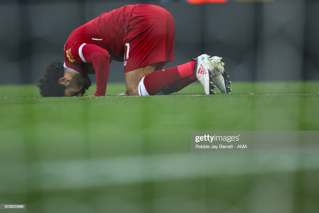 Mohamed Salah of Liverpool celebrates after scoring a goal to make it 2-0 during the Premier League match between Liverpool and West Ham United at Anfield on February 24, 2018 in Liverpool, England.