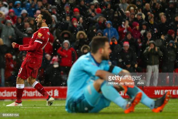 Mohamed Salah of Liverpool celebrates after scoring a goal to make it 40 during the Premier League match between Liverpool and Watford at Anfield on...