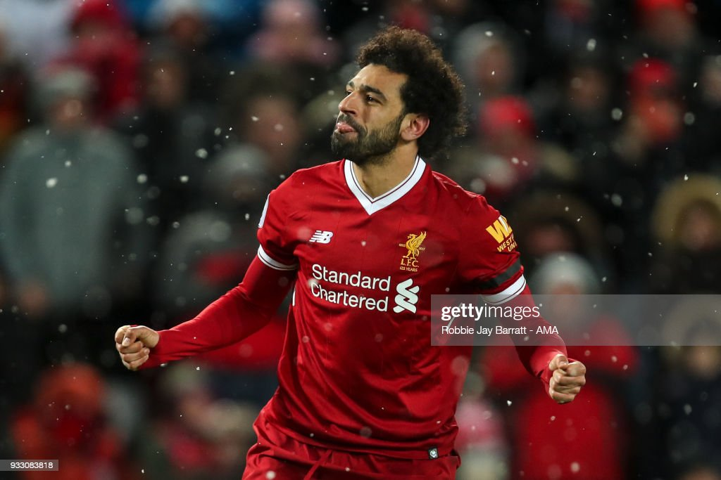 Mohamed Salah of Liverpool celebrates after scoring a goal to make it 4-0 during the Premier League match between Liverpool and Watford at Anfield on March 17, 2018 in Liverpool, England.