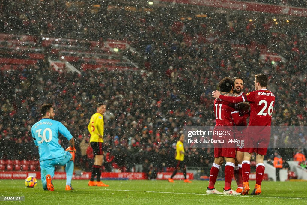 Mohamed Salah of Liverpool celebrates after scoring a goal to make it 5-0 during the Premier League match between Liverpool and Watford at Anfield on March 17, 2018 in Liverpool, England.